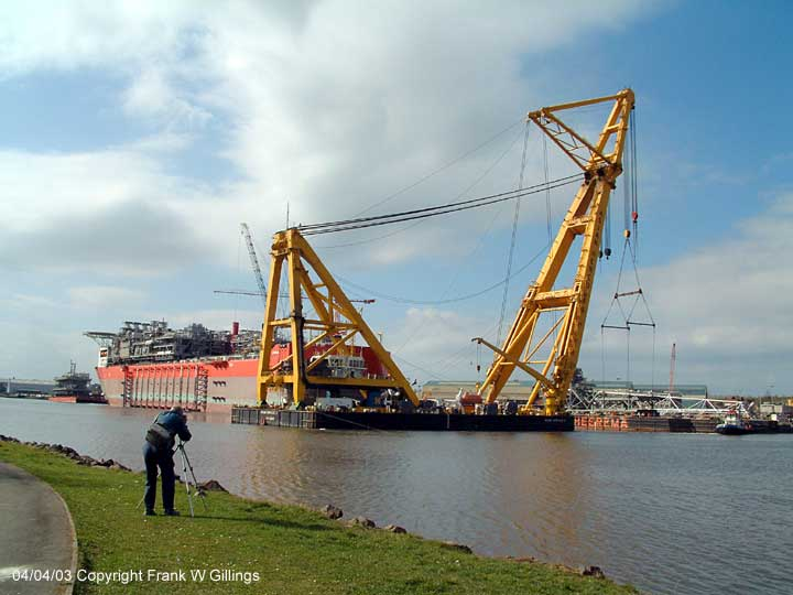 Asian Hercules II and the Bonga on the River Tyne. Photographer ready to capture image.